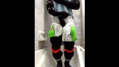 extreme football player with multiple pair of soccer sock.